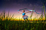 A ballerina under the milky way in the salt marsh grasses at Shell Point in Wakulla County, Florida