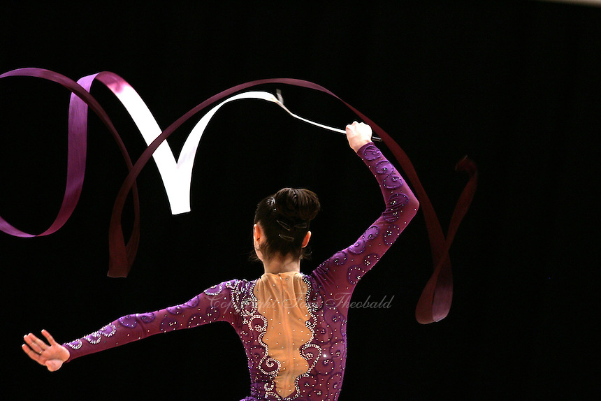 Anna Bessonova of Ukraine (here performing with ribbon routine) wins Gold, Silver and Bronze in rhythmic gymnastics apparatus finals at World Games from Duisburg, Germany on July 20-21, 2005.  Event finals in rhythmic gymnastics are only held at World Games. (Photo by Tom Theobald)
