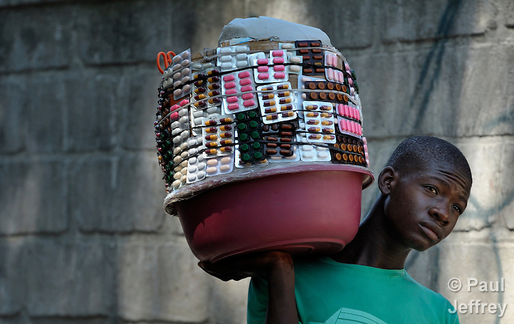 A man carries drugs for sale on a street in Port-au-Prince, Haiti.