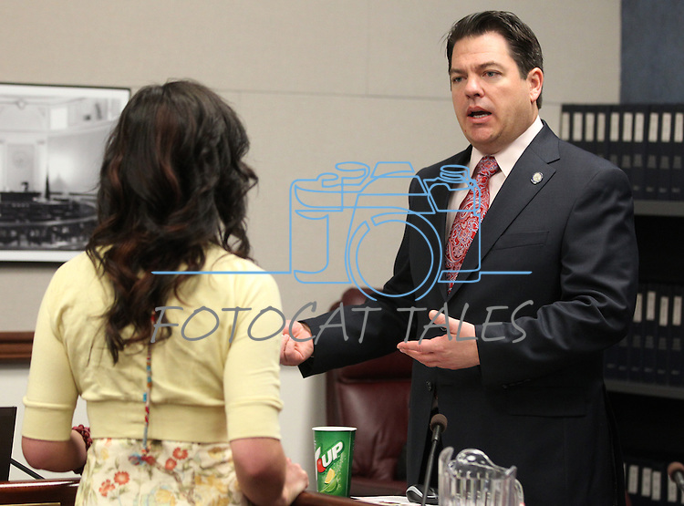 Nevada Sen. Michael Roberson, R-Las Vegas, talks with lobbyist Rebecca Gasca after a committee hearing Friday morning, May 6, 2011, at the Legislature in Carson City, Nev..Photo by Cathleen Allison