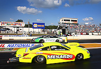 Aug. 16, 2013; Brainerd, MN, USA: NHRA pro stock driver Mark Martino (near lane) races alongside Erica Enders-Stevens during qualifying for the Lucas Oil Nationals at Brainerd International Raceway. Mandatory Credit: Mark J. Rebilas-