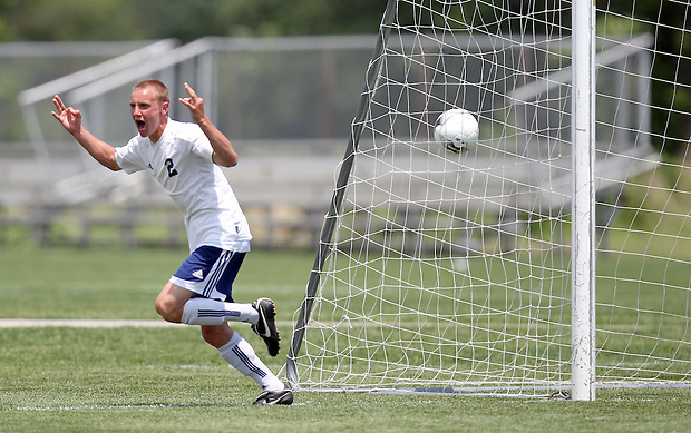 Iowa City Regina's Johhny Rummelhart celebrates his hat trick, scoring his third goal in the Regals' in a 3-0 win over Fort Madison Holy Trinity Catholic in the state soccer tournament on June 3.