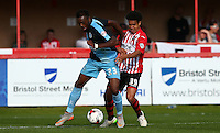 Gozie Ugwu of Wycombe Wanderers holds off Troy Brown of Exeter City during the Sky Bet League 2 match between Exeter City and Wycombe Wanderers at St James' Park, Exeter, England on 26 September 2015. Photo by Pinnacle Photo Agency.