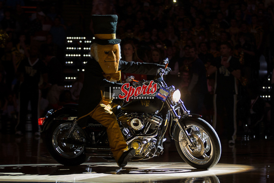 The Wake Forest Demon Deacons mascot rides into the LJVM Coliseum on his motorcycle prior to the start of the game against the North Carolina Tar Heels on January 21, 2015 in Winston-Salem, North Carolina.  (Brian Westerholt/Sports On Film)
