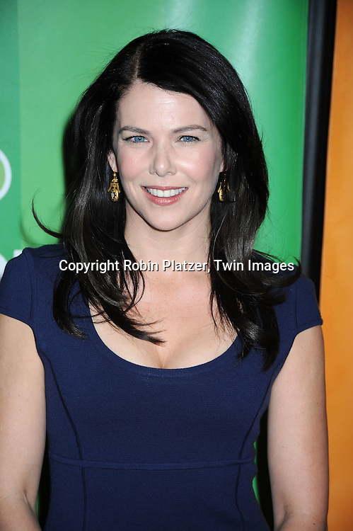 Lauren Graham posing for photographers at the NBC Universal Upfront announcement of their 2010-2011 season on May 17, 2010 at The New York Hilton Hotel in New York City.
