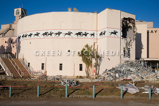 A building under demolition at the Bay Meadows race track. The demolition of the Bay Meadows Race Track facilities took place from September to October 2008. The horse racing track was demolished to make way for a large mixed use development including office space, residential units, retail space, and public parks. The site is located right next to the Hillsdale Caltrain station making it a perfect location for a transit oriented development (TOD) project. San Mateo, California, USA