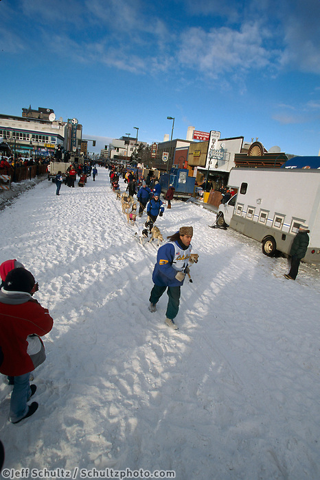 S.Perrino Walks Dogs to Start Line on 4th Ave..2004 Iditarod Anchorage