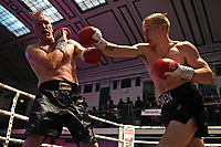 Jack Owen (black shorts) defeats Richard Harrison during a Boxing Show at York Hall on 7th September 2019