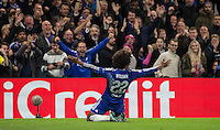 Willian of Chelsea slides on his knees in front the the supporters following his winning goal during the UEFA Champions League Group G match between Chelsea and Dynamo Kyiv at Stamford Bridge, London, England on 4 November 2015. Photo by Andy Rowland.