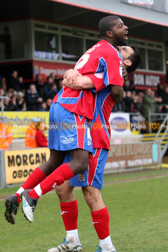 Medy Elito of Dagenham and Redbridge is congratulated for scoring the opening goal -  Dagenham and Redbridge vs Macclesfield - at the London Borough of Barking and Dagenham Stadium - 17/03/12 - MANDATORY CREDIT: Dave Simpson/TGSPHOTO - Self billing applies where appropriate - 0845 094 6026 - contact@tgsphoto.co.uk - NO UNPAID USE.