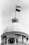 The only two flags to fly from atop the dome of Alabama State Capitol, those of the State and of the Confederacy. This and over 10,000 other images are part of the Jim Peppler Collection at The Alabama Department of Archives and History:  http://digital.archives.alabama.gov/cdm4/peppler.php