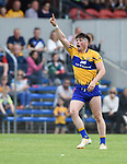 Keelan Sexton of Clare looks for a point top be flagged by umpires during their Munster championship quarter-final game against Limerick in Cusack park. Photograph by John Kelly.