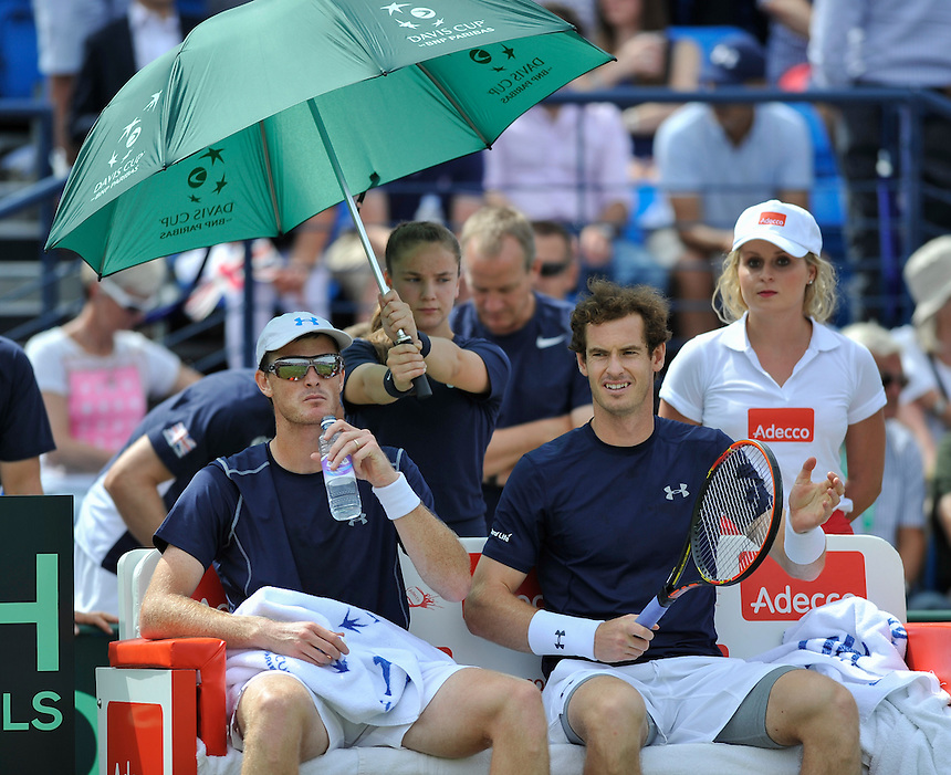 Andy Murray (right) with partner Jamie Murray during a break between games against Jo-Wilfried Tsonga and Nicolas Mahut in their doubles match today<br /> <br /> Photographer Ashley Western/CameraSport<br /> <br /> International Tennis - 2015 Davis Cup by BNP Paribas - World Group Quarterfinals - Great Britain v France - Day 2 - Saturday 18th July 2015 - Queens Club - London<br /> <br /> &copy; CameraSport - 43 Linden Ave. Countesthorpe. Leicester. England. LE8 5PG - Tel: +44 (0) 116 277 4147 - admin@camerasport.com - www.camerasport.com.
