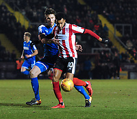 Lincoln City's Matt Green vies for possession with Notts County's Shaun Brisley<br /> <br /> Photographer Chris Vaughan/CameraSport<br /> <br /> The EFL Sky Bet League Two - Lincoln City v Notts County - Saturday 13th January 2018 - Sincil Bank - Lincoln<br /> <br /> World Copyright &copy; 2018 CameraSport. All rights reserved. 43 Linden Ave. Countesthorpe. Leicester. England. LE8 5PG - Tel: +44 (0) 116 277 4147 - admin@camerasport.com - www.camerasport.com