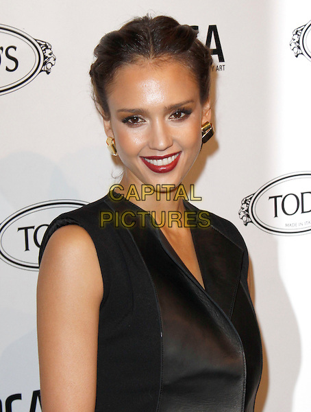 JESSICA ALBA.The Diego Della Valle Cocktail Celebration Honoring Tod's Beverly Hills Boutique And MOCA's New Director Jerry Deitch at Tod's Boutique in Beverly Hills, California, USA..April 15th, 2010        .headshot portrait make-up eyeshadow purple lipstick gold earring hair up black plait plaited braided braid hair up red sleeveless .CAP/RKE/DVS.©DVS/RockinExposures/Capital Pictures.