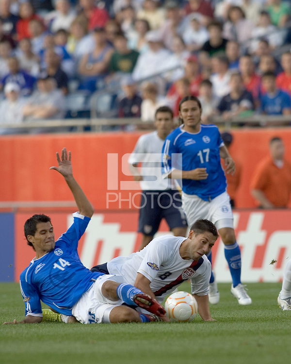 Ramon Sanchez (El Salvador, blue shirt) successfully tackles Clint Dempsey (United States, white shirt). The United States defeated El Salvador, 4-0, in the first round of the CONCACAF Gold Cup, in Gillette Stadium, Tuesday, June 12, 2007.