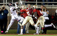 TALLAHASSEE, FL 11/19/11-FSU-UVA111911 CH-Florida State's Nigel Bradham, left and Terrance Parks can't stop Virginia's Perry Jones from making a touchdown catch during first half action Saturday at Doak Campbell Stadium in Tallahassee. .COLIN HACKLEY PHOTO