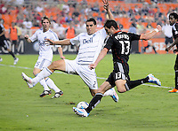 D.C. United midfielder Chris Pontius (13) goes against Vancouver Whitecaps FC defender Michael Boxall (2). D.C. United defeated The Vancouver Whitecaps FC 4-0 at RFK Stadium, Saturday August 13 , 2011.