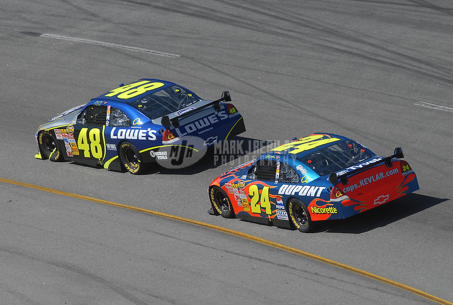 May 6, 2007; Richmond, VA, USA; Nascar Nextel Cup Series driver Jimmie Johnson (48) leads teammate Jeff Gordon (24) during the Jim Stewart 400 at Richmond International Raceway. The race is being run on Sunday after being rained out on Saturday evening. Mandatory Credit: Mark J. Rebilas-US PRESSWIRE Copyright © 2007 Mark J. Rebilas..