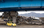 A car drives past a boat that was swept into a coastal  overpass in Miyako, Iwate Prefecture, Japan on  3 April 20011.  .Photographer: Robert Gilhooly