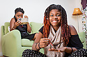 A family enjoys time at home at a CPDC community in Washington, D.C.<br /> <br /> (Photo by http://momentacreative.com)
