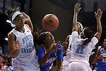 16 November 2014: UCLA's Jordin Canada (3) is fouled by North Carolina's Allisha Gray (15). The University of North Carolina Tar Heels hosted the University of California Los Angeles Bruins at Carmichael Arena in Chapel Hill, North Carolina in a 2014-15 NCAA Division I Women's Basketball game. UNC won the game 84-68.
