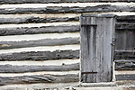 historical log cabin window building logcabin structure old past long ago 150 years historic deterioration aging fashioned glass wood recycle build by hand home house farm settlement settle memories united states west time plaster construction material stripes door security locked lock secure safe protected preservation preserve logs shutters