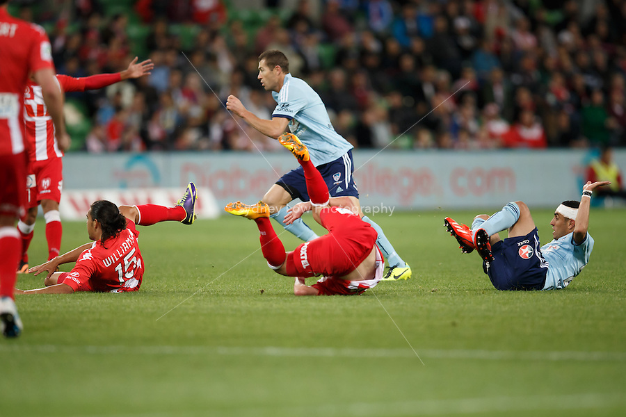 Players go down after a tackle in the round six match between Melbourne Heart and Sydney FC in the Australian Hyundai A-League 2013-24 season at AAMI Park, Melbourne, Australia.<br /> This image is not for sale. Please visit zumapress.com for image licensing.