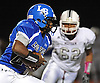 Long Beach running back No. 24 Tyreek Bromley rushes for a gain during a Nassau County Conference II varsity football game against Mepham at Long Beach Middle School on Friday, October 16, 2015. Mepham led 14-0 at halftime.<br /> <br /> James Escher