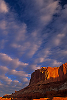 731350057v afternoon clouds form up over brilliant red sandstone formations and the waterpocket fold in capitol reef national park utah
