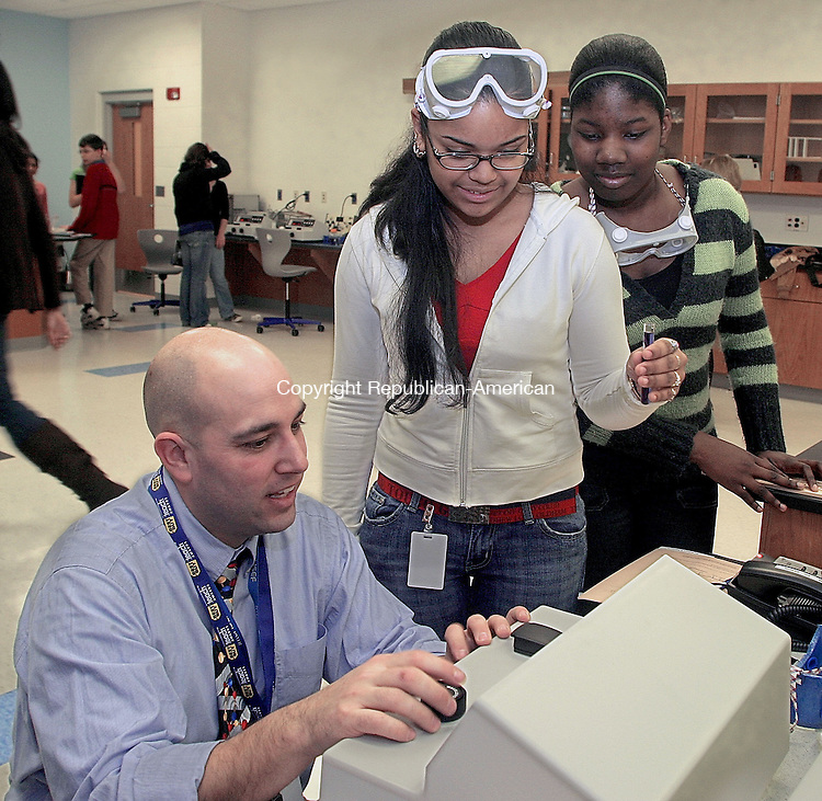 OXFORD, CT -09 JANUARY 2007 -010908DA02-  Oxford High School Science Department Chair, Frank LaBanca, left, instructs Spectrometry lab work with students, Josalyn Vazquez, center, and Anna-Kay Beckford, right, during a Ct Academy of Science Research Oxford High School Interdistrict Event Wednesday. Students were educated by speakers and worked in integrated groups with students from different schools doing experiments using scientific instrumentation.<br /> Darlene Douty/Republican-American