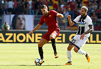 Calcio, Serie A: Roma vs Udinese. Roma, stadio Olimpico, 23 settembre 2017.<br /> Roma&rsquo;s Kevin Strootman, left, is chased by Udinese&rsquo;s Valon Behrami during the Italian Serie A football match between Roma and Udinese at Rome's Olympic stadium, 23 September 2017. Roma won 3-1.<br /> UPDATE IMAGES PRESS/Riccardo De Luca