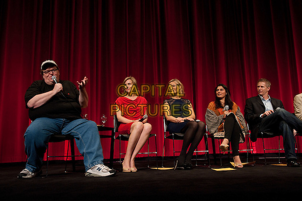 "(Far left) Host Michael Moore with the Oscar nominated Documentary Short filmmakers (from left to right): Kira Carstensen, ""The Tsunami and the Cherry Blossom"", Lucy Walker, ""The Tsunami and the Cherry Blossom"", Shareen Obaid-Chinoy, ""Saving Face"" and Dan Junge, ""Saving Face""; during the Academy of Motion Picture Arts and Sciences' ""DOCS!"" event on Wednesday, February 22, 2012 at the Samuel Goldwyn Theater in Beverly Hills.  The 84th Academy Awards® will be presented on Sunday, February 26, 2012, at the Hollywood & Highland Center®, and televised live by the ABC Television Network..* Editorial Use Only*.oscars full length black suit blue trousers sitting overweight red dress .CAP/A.M.P.A.S./NFS.©A.M.P.A.S. Supplied by Capital Pictures. Oscars"