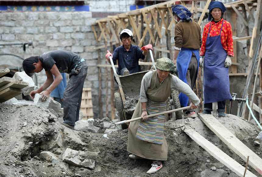 Tibetan men and women work on a onstruction site in central Lhasa.