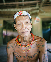 A Mentawai shaman or locally called Sikerei, living in the village of Madobag. The Mentawai are the tribes living traditionally in the island of Siberut, Indonesia. Here, where the changes came slow, some of the people are still living like their ancestors did centuries ago. They s till practice ancient religion called Arat Sabulungan, which believe that everything in the forest has a spirit.