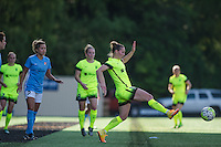 Seattle, WA - Sunday, April 17, 2016: Seattle Reign FC forward Manon Melis (14) passes the ball during the second half of the match. Sky Blue FC defeated the Seattle Reign FC 2-1 during a National Women's Soccer League (NWSL) match at Memorial Stadium.