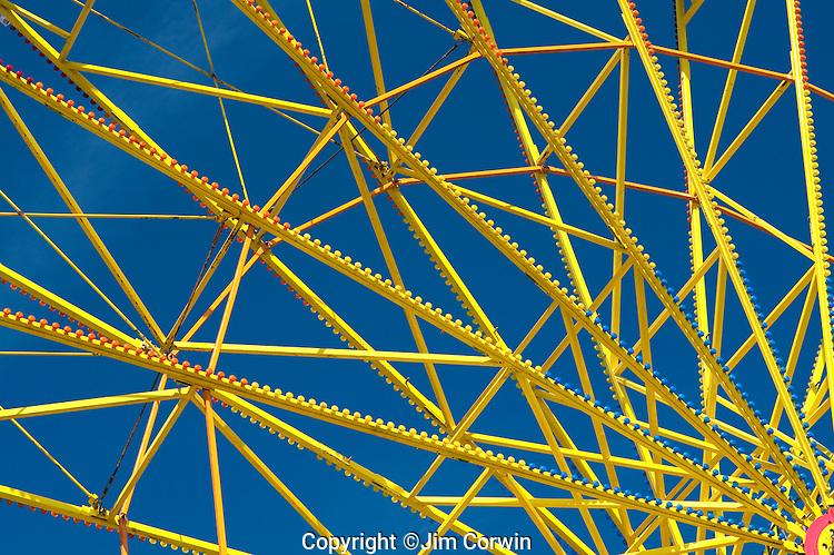 Evergrene State Fair close up of yellow ferris wheel spokes Monroe Washington State USA