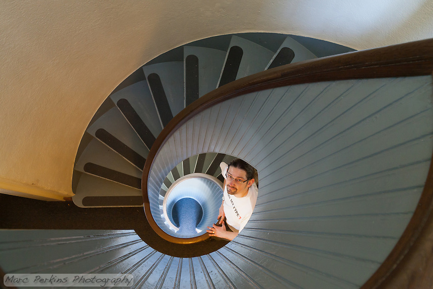 I'm standing on the second level of the stairway to the top of the Old Point Loma Lighthouse in Cabrillo National Monument, looking up at the camera.  Greg (of Alpenglow Images Photography) is nicely pressing the trigger of my tripod-mounted camera.