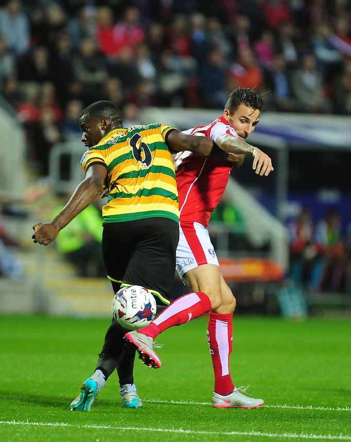 Rotherham United's Matt Derbyshire vies for possession with Norwich City's Sebastien Bassong<br /> <br /> Photographer Andrew Vaughan/CameraSport<br /> <br /> Football - Capital One Cup Second Round - Rotherham United v Norwich - Tuesday 25th August 2015 - New York Stadium - Rotherham<br />  <br /> &copy; CameraSport - 43 Linden Ave. Countesthorpe. Leicester. England. LE8 5PG - Tel: +44 (0) 116 277 4147 - admin@camerasport.com - www.camerasport.com