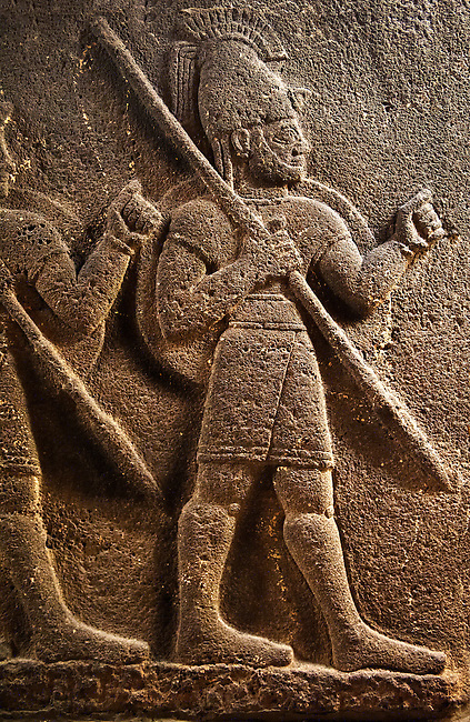 Picture of Neo-Hittite orthostat with releif sculpture of 3 soldiers from the legend of Gilgamesh from Karkamis,Turkey.  An Ankara Museum of Anatolian Civilizations exhibit.