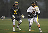 Gordon Purdie, Jr. #9 of Adelphi University, left, carries downfield during a rain-filled first round game against Pace in the NCAA Division II Tournament at Motamed Field in Garden City, NY on Saturday, May 13, 2017.