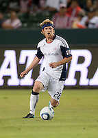 Revolution midfielder Pat Phelan (28) moves ball up the pitch during the first half of the game between Chivas USA and the New England Revolution at the Home Depot Center in Carson, CA, on September 10, 2010. Chivas USA 2, New England Revolution 0.