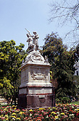 Santiago, Chile. Ornate monument dedicated to Simon Bolivar; statue of a man and a woman in a classical pose.