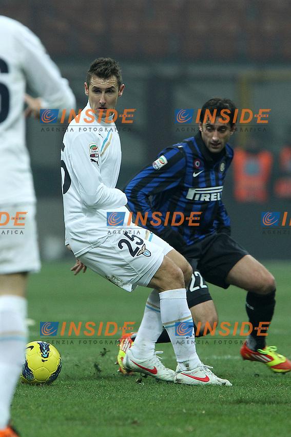 """Miroslav Klose Lazio Diego Milito Inter.Milano 22/01/2012 Stadio """"S.Siro"""".Football / Calcio Serie A 2011/2012.Inter vs Lazio.Foto Insidefoto Paolo Nucci"""