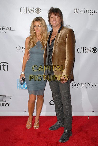 DENISE RICHARDS & RICHIE SAMBORA.Conde Nast Media Group's Third Annual Fashion Rocks Concert at Radio City Music Hall, New York, NY, USA,.7 September 2006..full length blue grey halterneck dress tanned diamante hoop earrings couple ritchie.Ref: ADM/PH.www.capitalpictures.com.sales@capitalpictures.com.©Paul Hawthorne/AdMedia/Capital Pictures. *** Local Caption ***