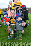 Padraig Reidy celebrates with his boys Oisin and Tiernan and the Inter Firm cup after defeating  Intel in the All Ireland Inter Firm final in Fossa on Saturday
