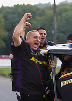 Oct 2, 2016; Mohnton, PA, USA; Crew members for NHRA pro stock driver Vincent Nobile celebrates after winning the Dodge Nationals at Maple Grove Raceway. Mandatory Credit: Mark J. Rebilas-USA TODAY Sports