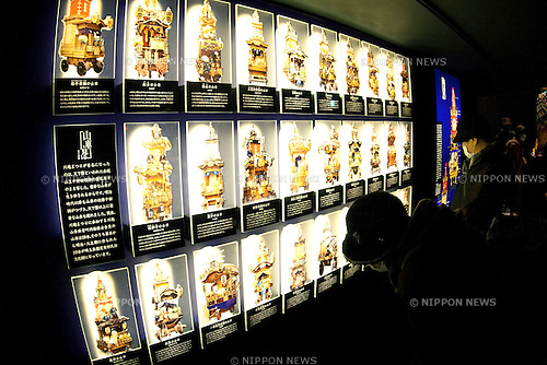 """February 14, 2013, Kawagoe, Japan - Visitors see the different kinds of dashi (portable shrine) at the Kawagoe Festival Museum. An old town from Edo Period (1603-1867) is located in Kawagoe, 30 minutes by train from central Tokyo. In the past Kawagoe was an important city for trade and strategic purpose, the shogun installed some of their most important loyal men as lords of Kawagoe Castle. Every year """"Kawagoe Festival"""" is held in the third weekend of October, people pull portable shrine during the parade, later """"dashi"""" floats on the streets nearby. The festival started 360 years ago supported by Nobutsuna Matsudaira, lord of Kawagoe Castle. (Photo by Rodrigo Reyes Marin/AFLO).."""