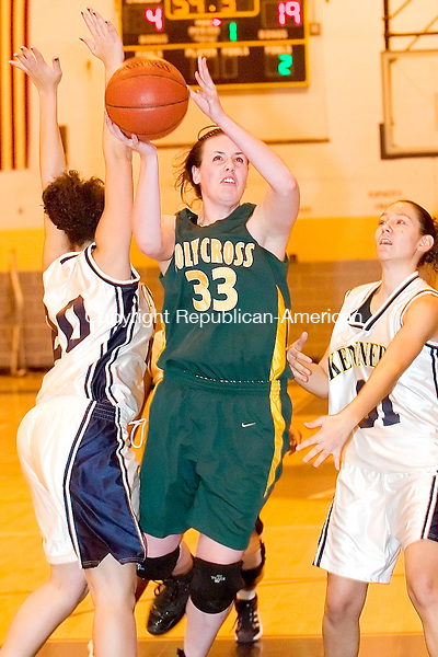 WATERBURY, CT- 27 DEC 2007- 122707JT06-<br /> Holy Cross' Tara Stevenson gets past Kennedy's Kasiana Goodman, left, and Deborah Rosado during Thursday's game at Kennedy. Cross won, 77-47.<br /> Josalee Thrift / Republican-American
