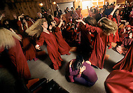 Wasco, Oregon, January 1984: Disciples of Bhagwan Rajneesh dancing during the Darshan Ceremony in Rajneeshpuram, where new members were baptized by a grand priest every Sunday evening. Rajneeshpuram, was an intentional community in Wasco County, Oregon, briefly incorporated as a city in the 1980s, which was populated with followers of the spiritual teacher Osho, then known as Bhagwan Shree Rajneesh. The community was developed by turning a ranch from an empty rural property into a city complete with typical urban infrastructure, with population of about 7000 followers.